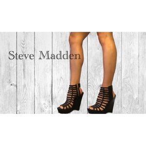 Steve Madden Black high heeled wedges.